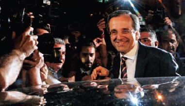 ▲希臘國會選舉被稱為「壞」與「更壞」的選擇,新民主黨黨魁薩馬拉斯(前)屬於前者,現在正被兩黨協商弄得焦頭爛額。