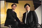 康程昌(右)與康程華(左)聯手打造國聯新風貌。