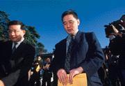 ■王文洋(右)回台宴請工研院高層,為的可是光纖產業投資?