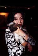 陳文茜常把男人和懷裡的小狗相提並論。