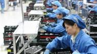 中國股市崩、出口衰、人民幣貶...《經濟學人》為什麼依然看好它?