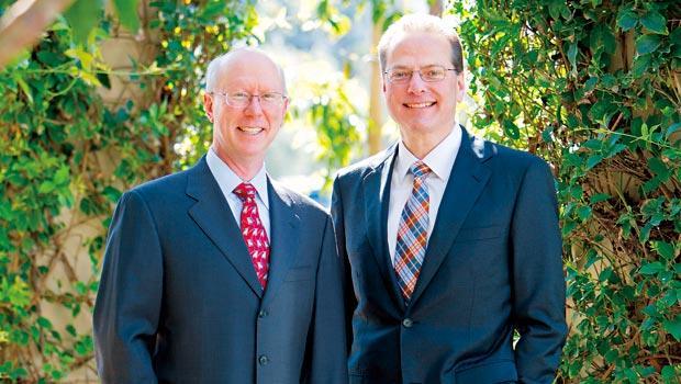 博通董事長山繆利(右)與執行長麥奎格(左)主導結束虧損手機基頻晶片,聚焦商機更大的物聯網。