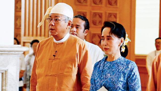 緬甸總統吳廷覺(左)是杜欽芝基金會高級主管,杜欽芝即是翁山蘇姬(右)之母。