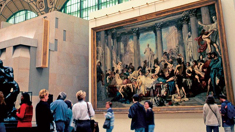 奧塞大廳掛著古典學院派畫家庫蒂爾(Thomas Couture)花3年繪製,尺寸達472X772公分的巨幅畫作〈頹廢的羅馬人〉 。