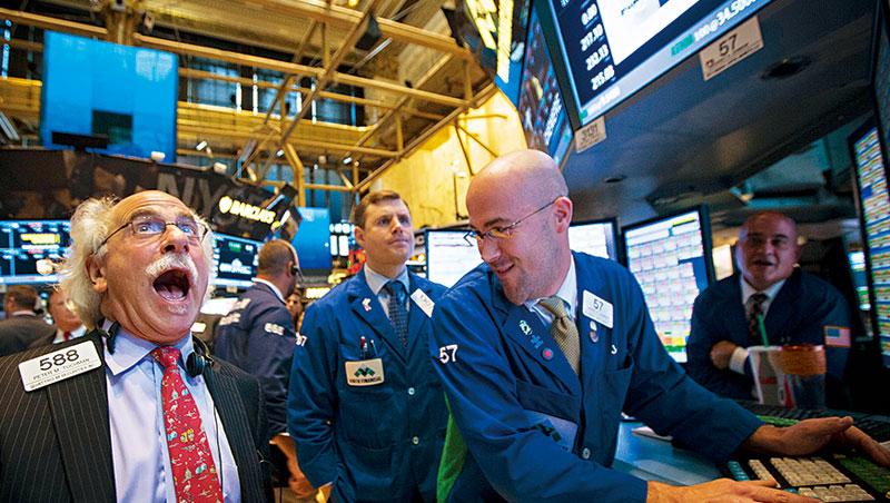 美國生技股大漲時,紐約證交所交易員樂得合不攏嘴,但今年十月中旬卻豬羊變色翻盤下跌。