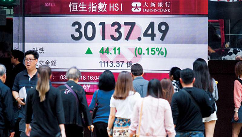 恒生指數今年2月股災前,漲勢冠居全球已開發市場,中資南下注入資金是最大功臣。