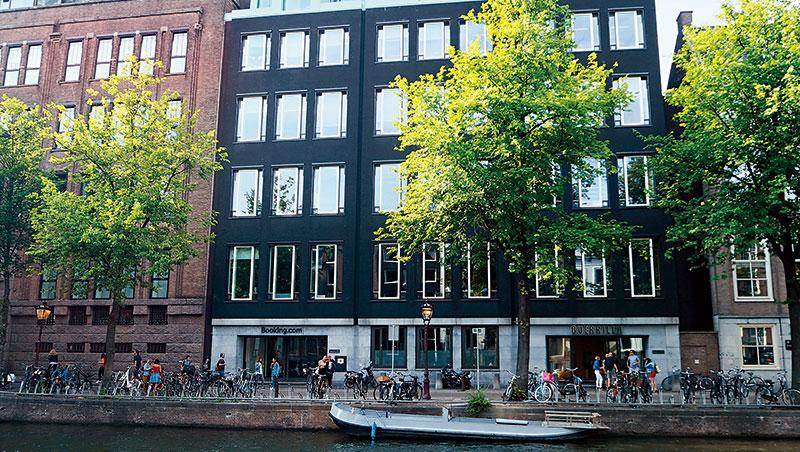 保有新創精神的「網路活化石」》走進位在阿姆斯特丹市中心、正對運河的 Booking.com 總部