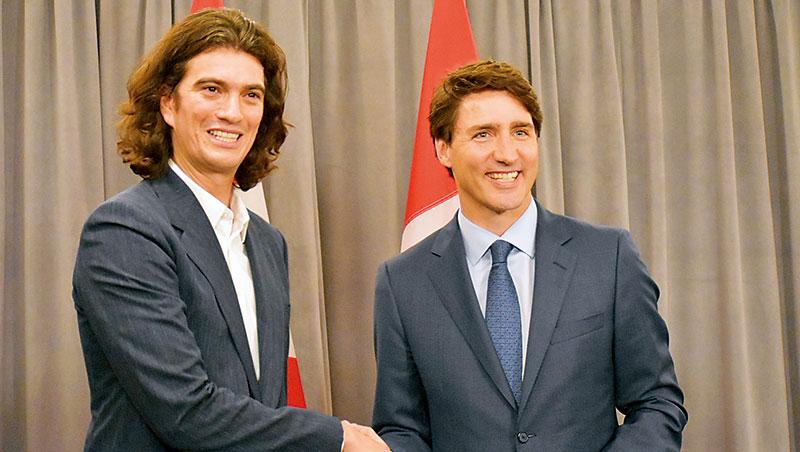 科技打造分租辦公室,連加拿大總理杜魯多(右)都讚美WeWork「正改變人們工作方式。」