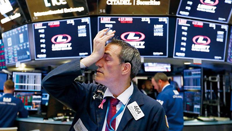 10月下旬美股大跌,今年以來漲幅全數回吐,令紐約證交所交易員崩潰。