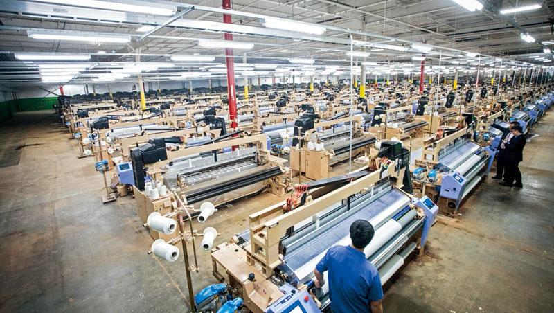 因應勞動成本增加、各國關稅調整等問題,台灣各大紡織廠近年紛紛往海外布局擴點。圖為宏遠美國北卡羅來納州廠。